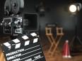 Video, movie, cinema concept. Retro camera, flash, clapperboard