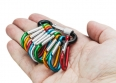colorful carabiner climbing in hand isolated