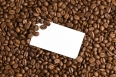 white card on coffee beans background